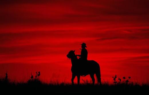 Stock Photo: 112-6072C Silhouette of a person riding a horse, Colorado, USA