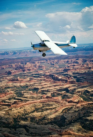Private airplane flying over an arid landscape, Canyonlands National Park, San Juan County, Canyonlands, Utah, USA : Stock Photo