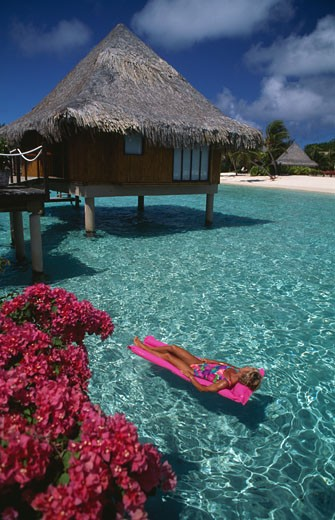 Stock Photo: 112-8748D Woman sunbathing on a pool raft, Hotel Moana Beach, Bora Bora, French Polynesia