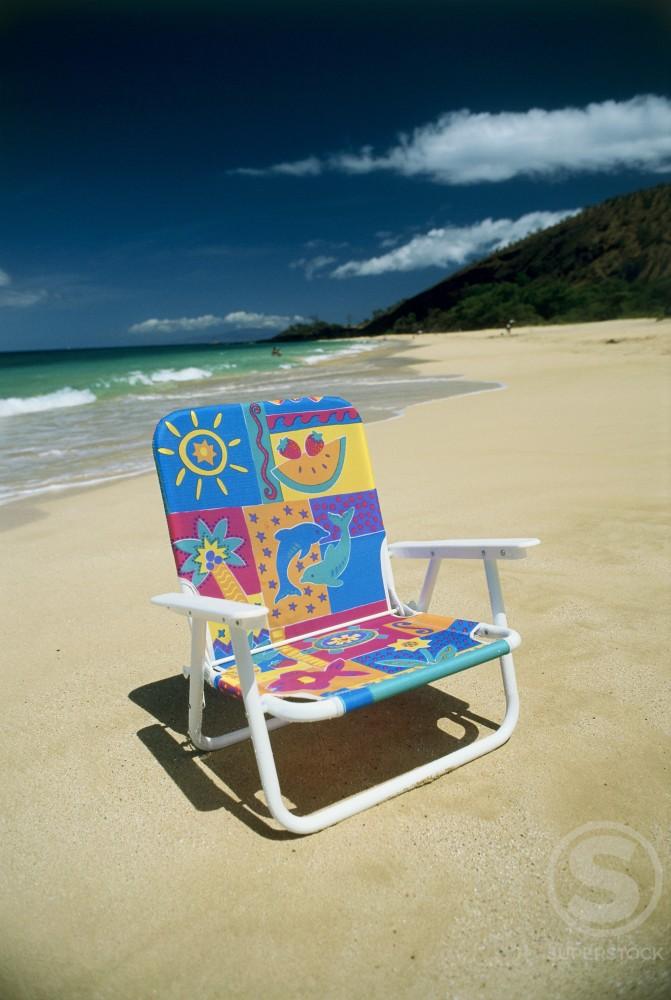 Stock Photo: 112-9813 Close-up of an empty chair on the beach, Maui, Hawaii, USA