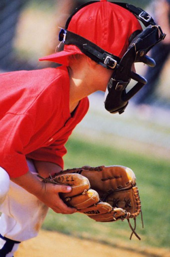 Child playing baseball : Stock Photo
