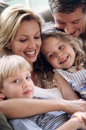 Stock Photo: 1128-224 Close-up of a mid adult couple with their son and daughter smiling