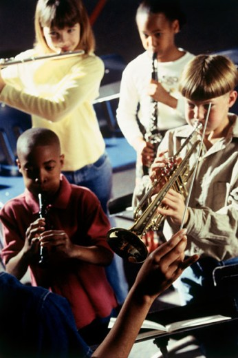 Stock Photo: 1128-400 Four children learning music