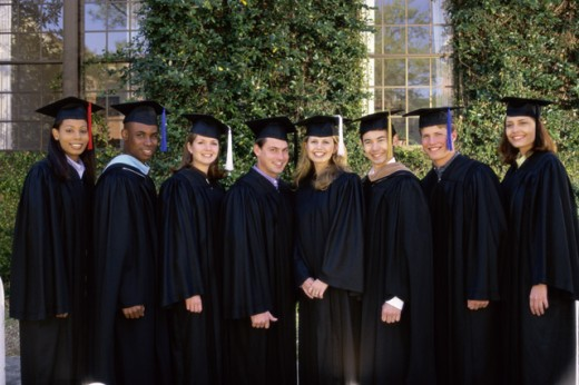 Stock Photo: 1128-531 Portrait of a group of young graduates standing in a row