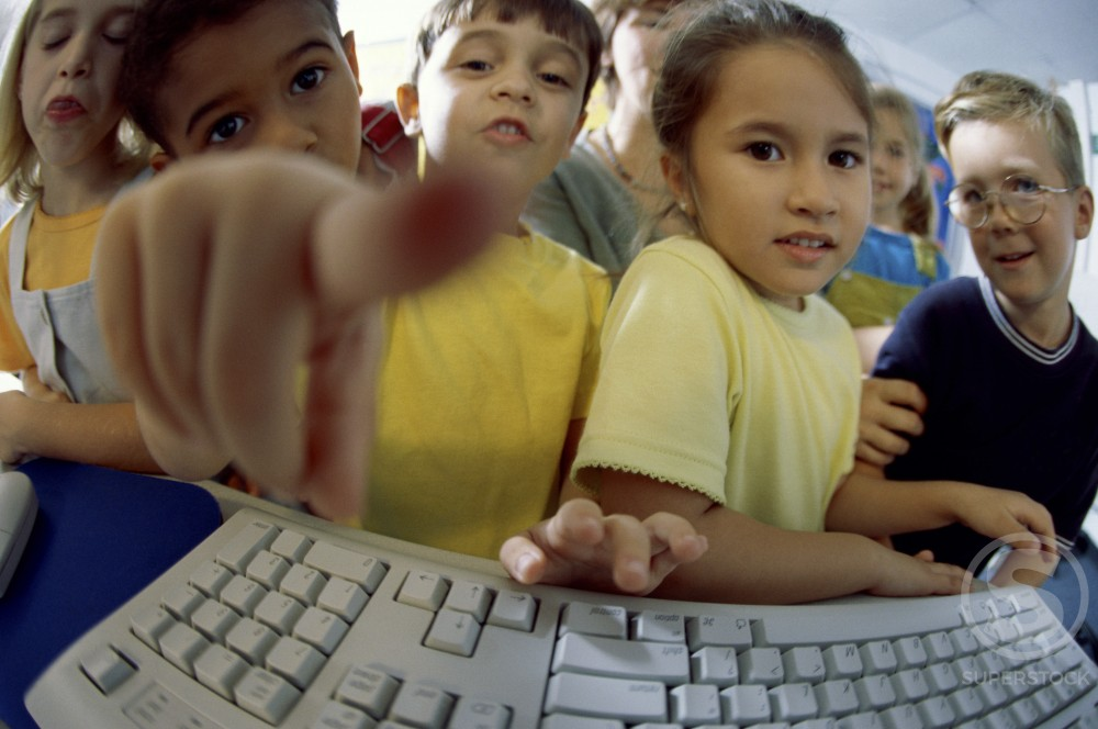 Stock Photo: 1128-796A Children in front of a computer