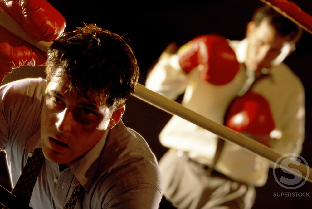 Stock Photo: 1128-862 Two businessmen in a boxing ring