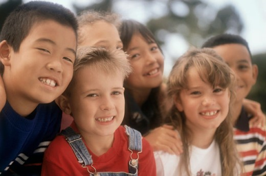 Stock Photo: 1148-139 Close-up of a group of boys and girls smiling