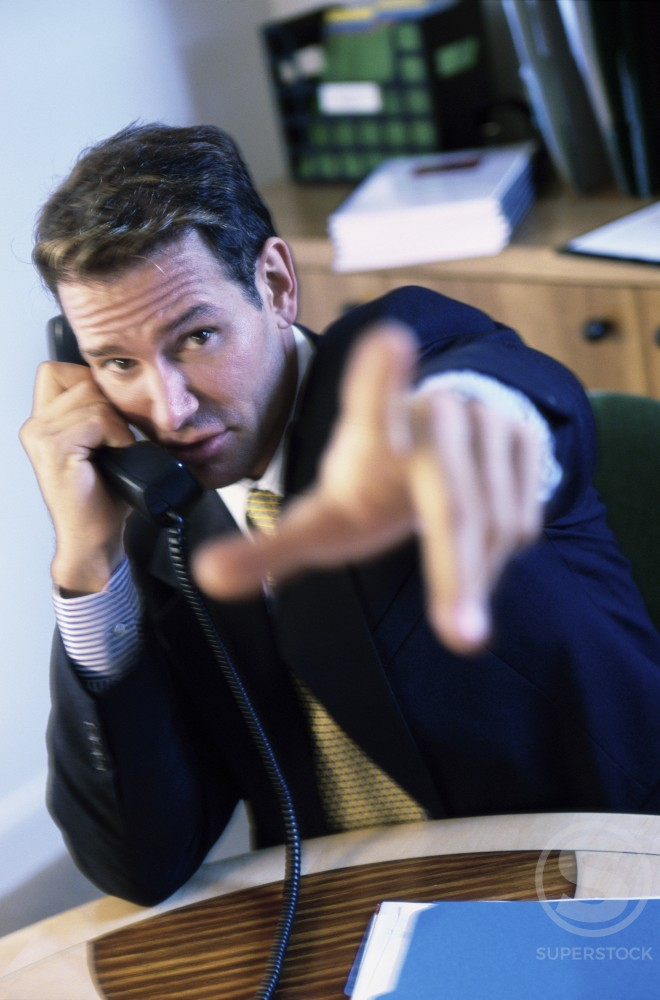 Stock Photo: 1166-2199 Portrait of a businessman talking on the telephone