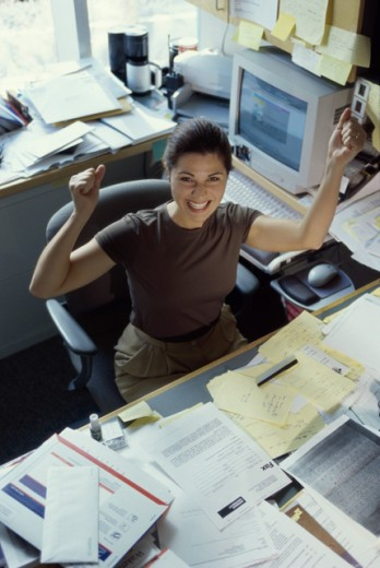 Portrait of a businesswoman with her arms raised : Stock Photo