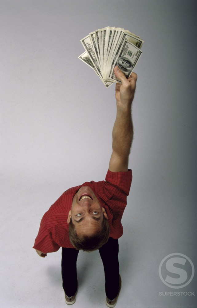 Stock Photo: 1166-3464 Rear view of a mid adult man holding American banknotes