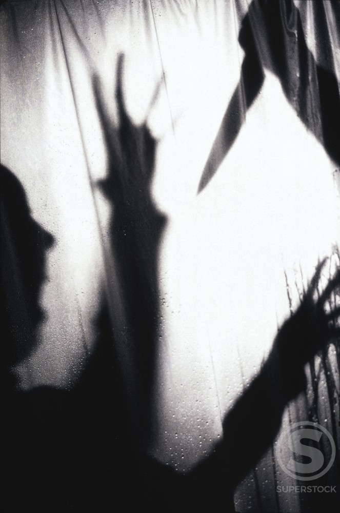 Stock Photo: 1166-3722 Shadow of a person getting stabbed