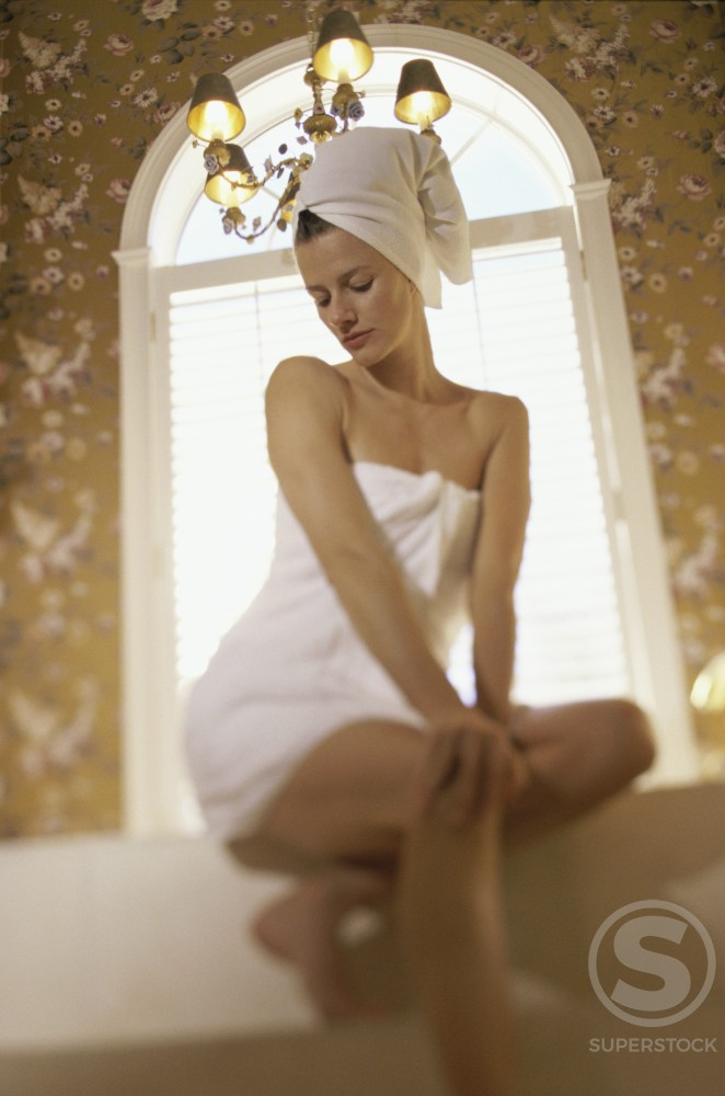 Young woman wrapped in a towel : Stock Photo