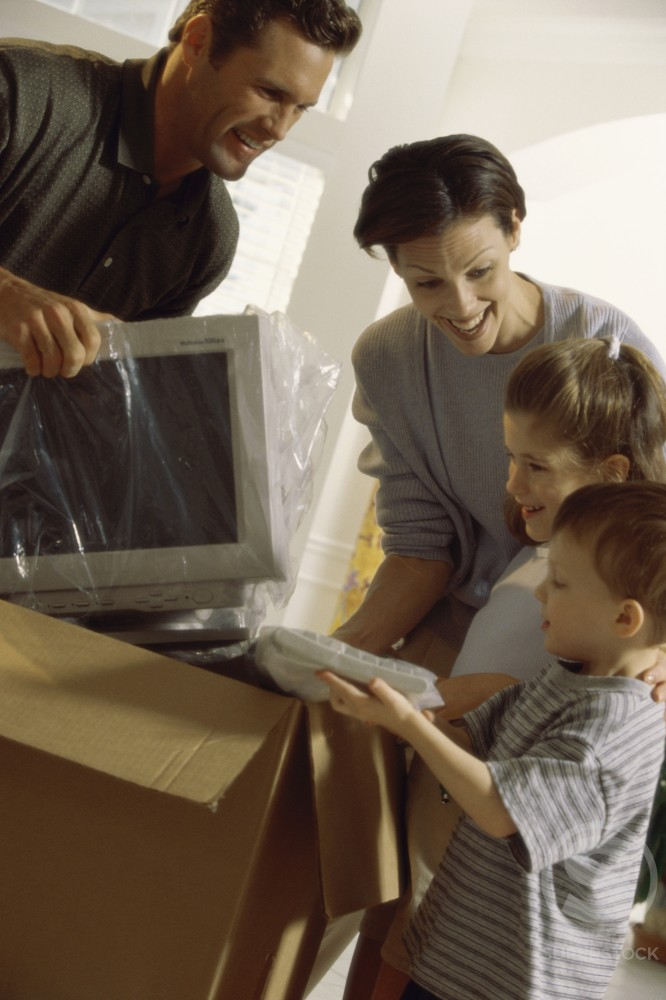 Stock Photo: 1166-471 Family unpacking a computer monitor