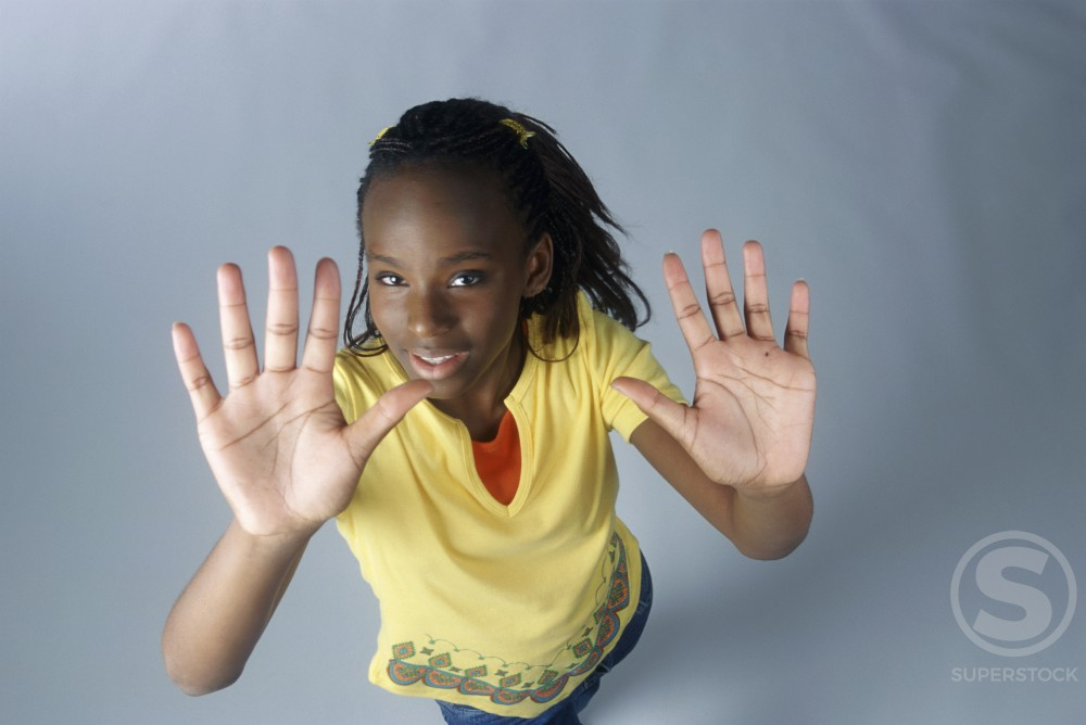 Stock Photo: 1166R-3705 Portrait of a teenage girl holding out her hands