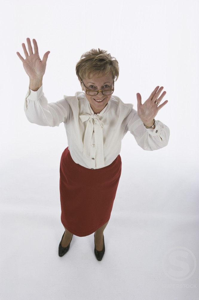 Portrait of a senior woman waving : Stock Photo