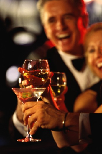 Stock Photo: 1166R-5064 Two people toasting at a bar