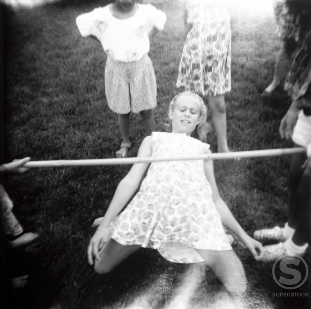 Stock Photo: 1172-102 Group of children doing the limbo