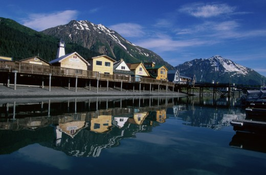 Reflection of houses in water, Seward, Alaska, USA : Stock Photo