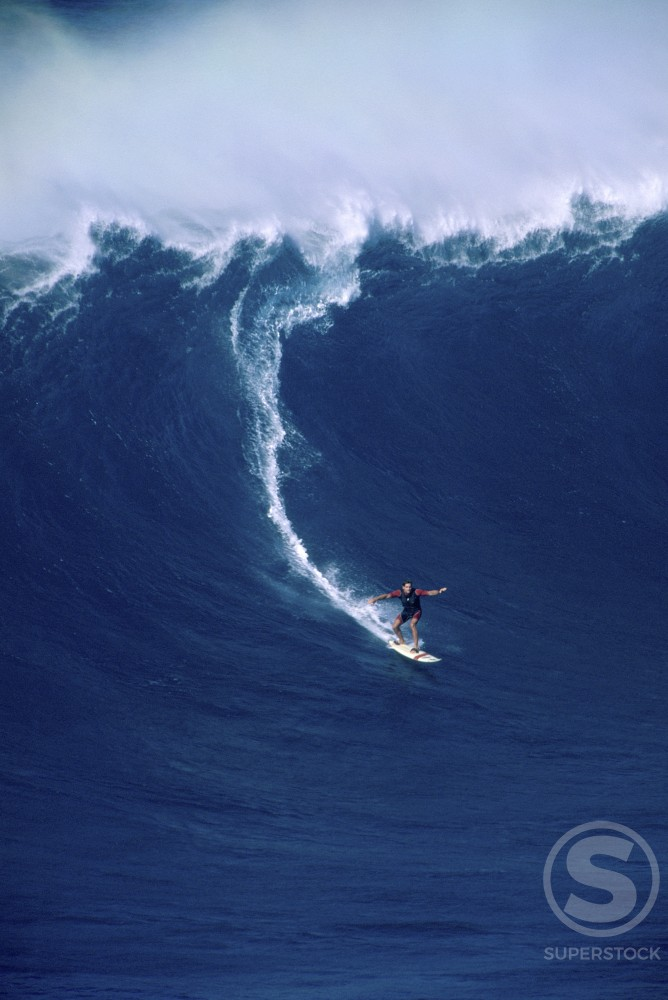High angle view of a man surfing on a wave, Peahi, Maui, Hawaii, USA : Stock Photo