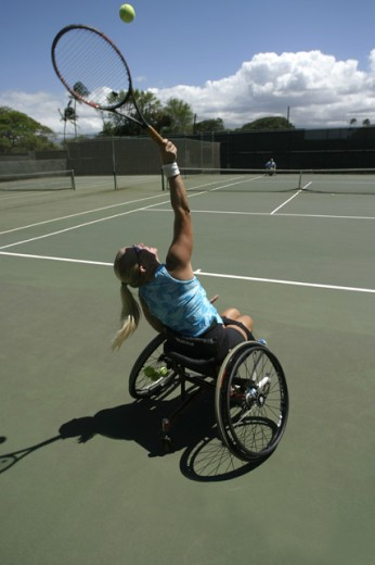 Stock Photo: 1176-427 Rear view of a young woman in a wheelchair playing tennis, Maui, Hawaii, USA