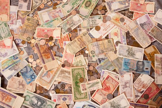 Collection of currency notes and coins from around the world : Stock Photo