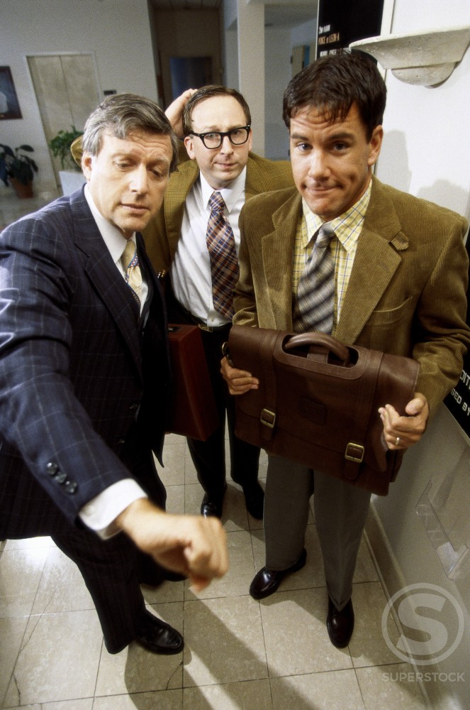 Stock Photo: 1179-195 Three businessmen in an office