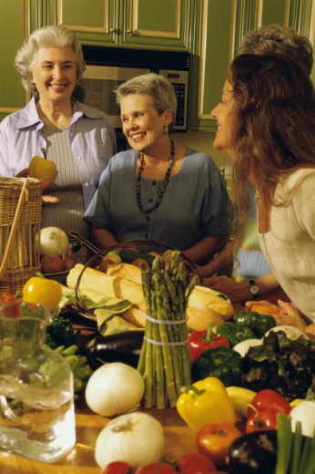 Group of women in a kitchen : Stock Photo