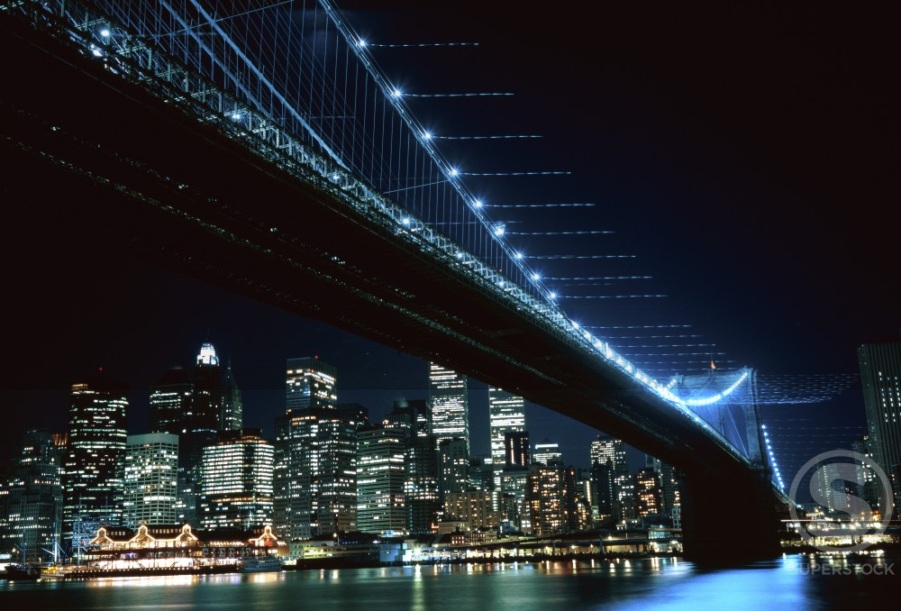 Stock Photo: 1183-280 Low angle view of a suspension bridge across a river lit up at night, Brooklyn Bridge, Brooklyn, New York City, New York, USA