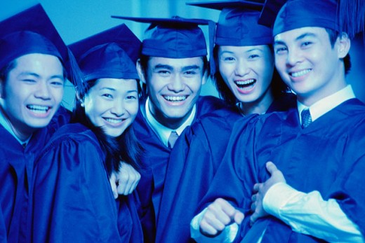 Portrait of five college students celebrating their graduation : Stock Photo