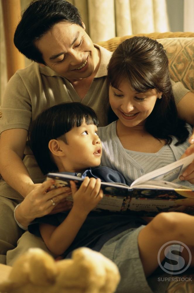 Stock Photo: 1188-801 Parents with their son reading a book