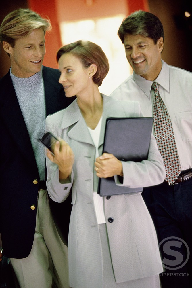 Stock Photo: 1189-131 Two businessmen and a businesswoman talking