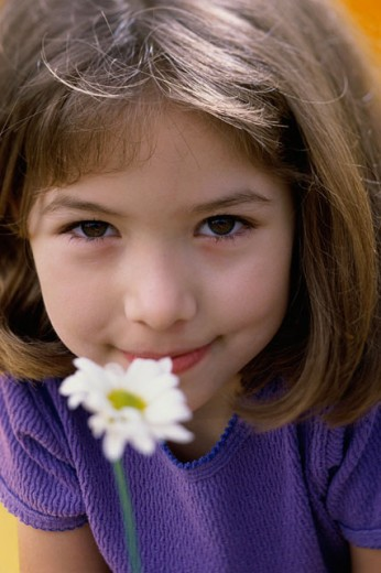 Stock Photo: 1189-1645A Portrait of a girl smelling a flower