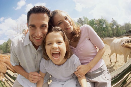 Stock Photo: 1189-1934D Mid adult couple with their daughter smiling
