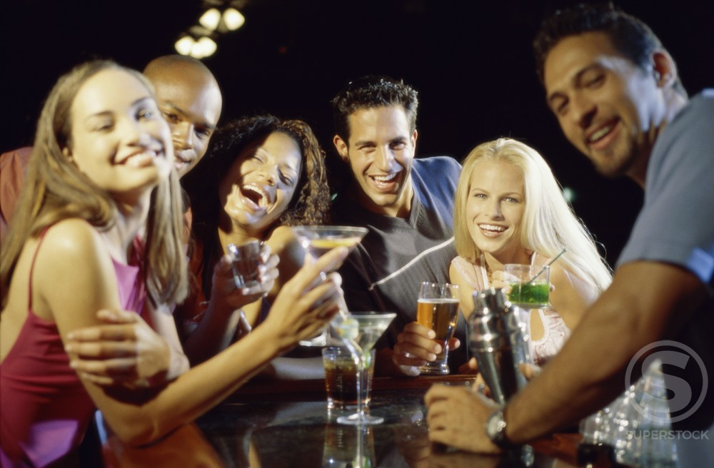 Stock Photo: 1189-2125 Portrait of a group of young people drinking in a bar