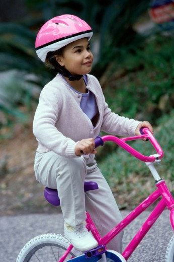 Side profile of a girl riding a bike : Stock Photo