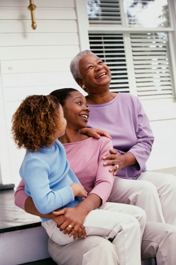 Stock Photo: 1189-2227C Girl sitting with her mother and grandmother