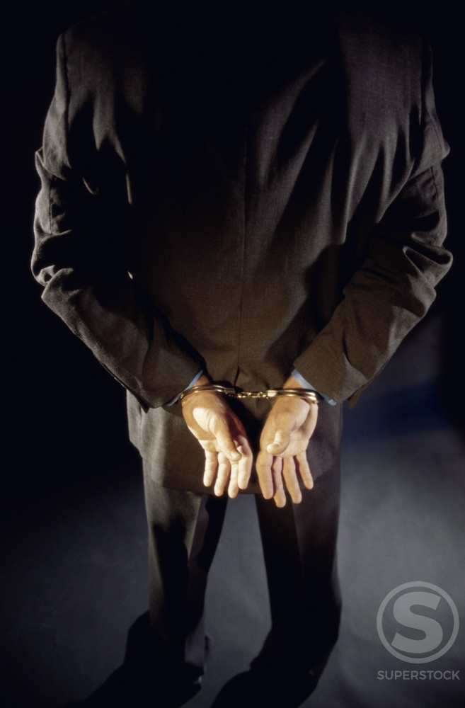 Rear view of a man in handcuffs : Stock Photo
