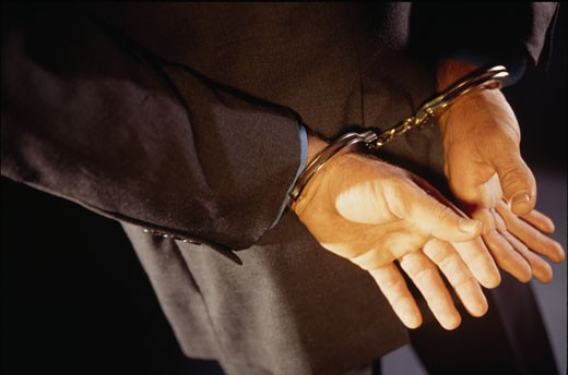 Stock Photo: 1189-2530A Close-up of a man in handcuffs