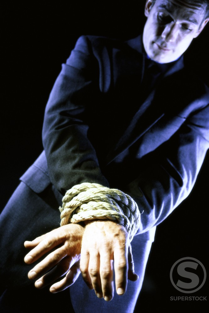 Stock Photo: 1189-2536 Businessman's hands tied together with a rope