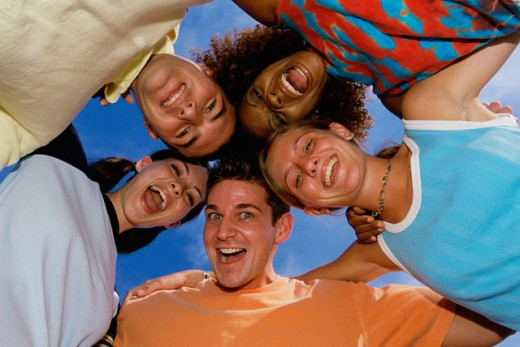 Low angle view of five people in a huddle : Stock Photo