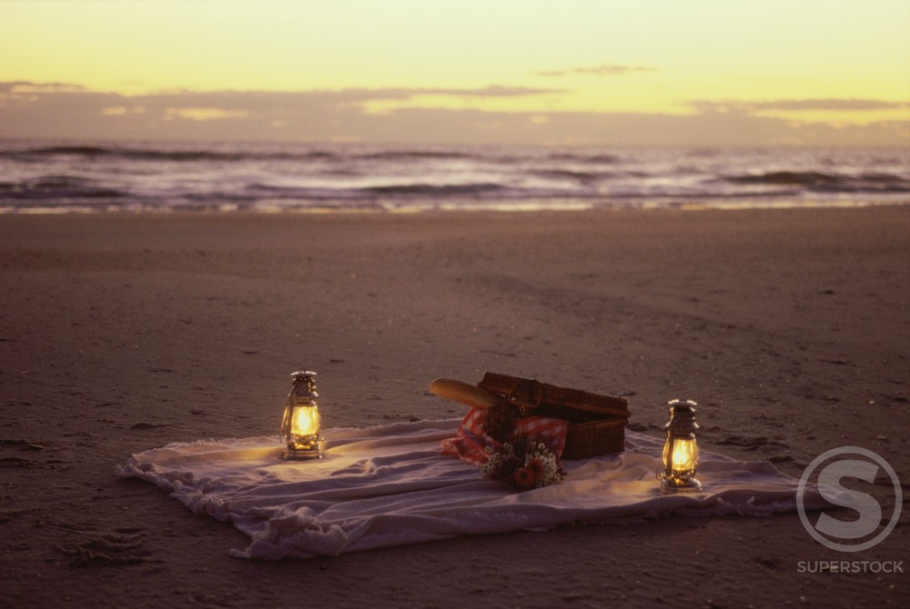 Stock Photo: 1189-2995E Two lanterns and a sheet of cloth on the beach