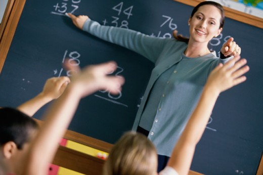 Stock Photo: 1189-310 Students raising their hands in a classroom
