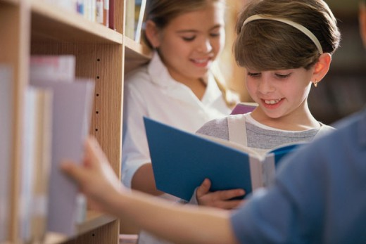 Stock Photo: 1189-316 Two girls reading books in a library
