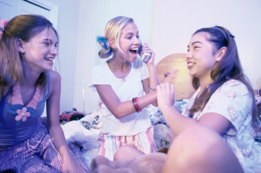 Stock Photo: 1189-3841 Three teenage girls at a slumber party