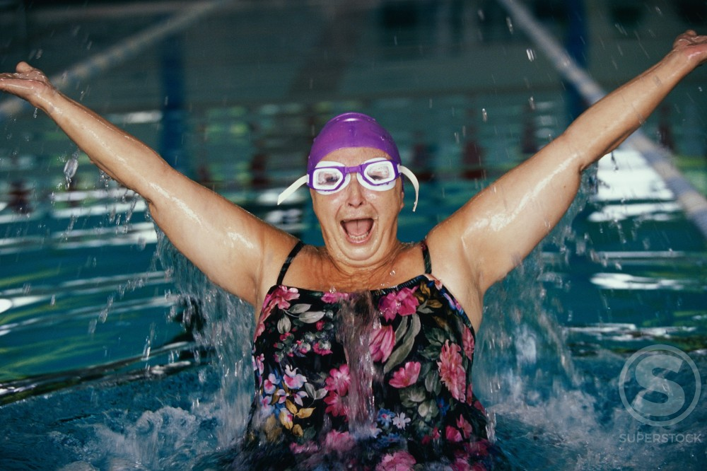 Stock Photo: 1189-566B Portrait of a senior woman splashing in a swimming pool