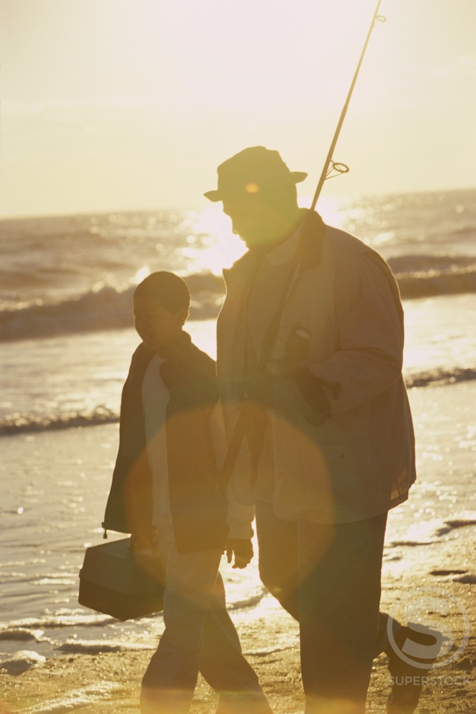 Stock Photo: 1189R-2928 Father and son walking on the beach