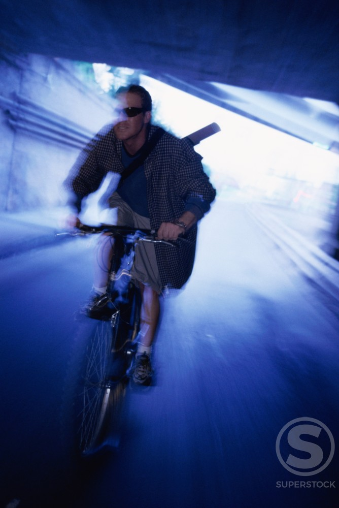 Male messenger riding a bicycle : Stock Photo