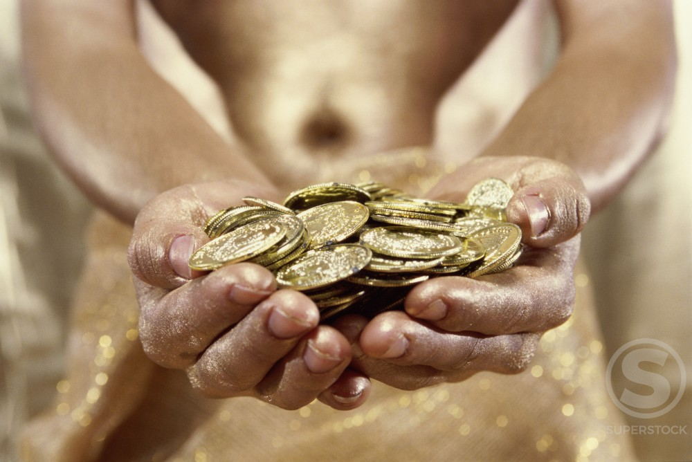 Stock Photo: 1189R-3617 Person holding gold coins