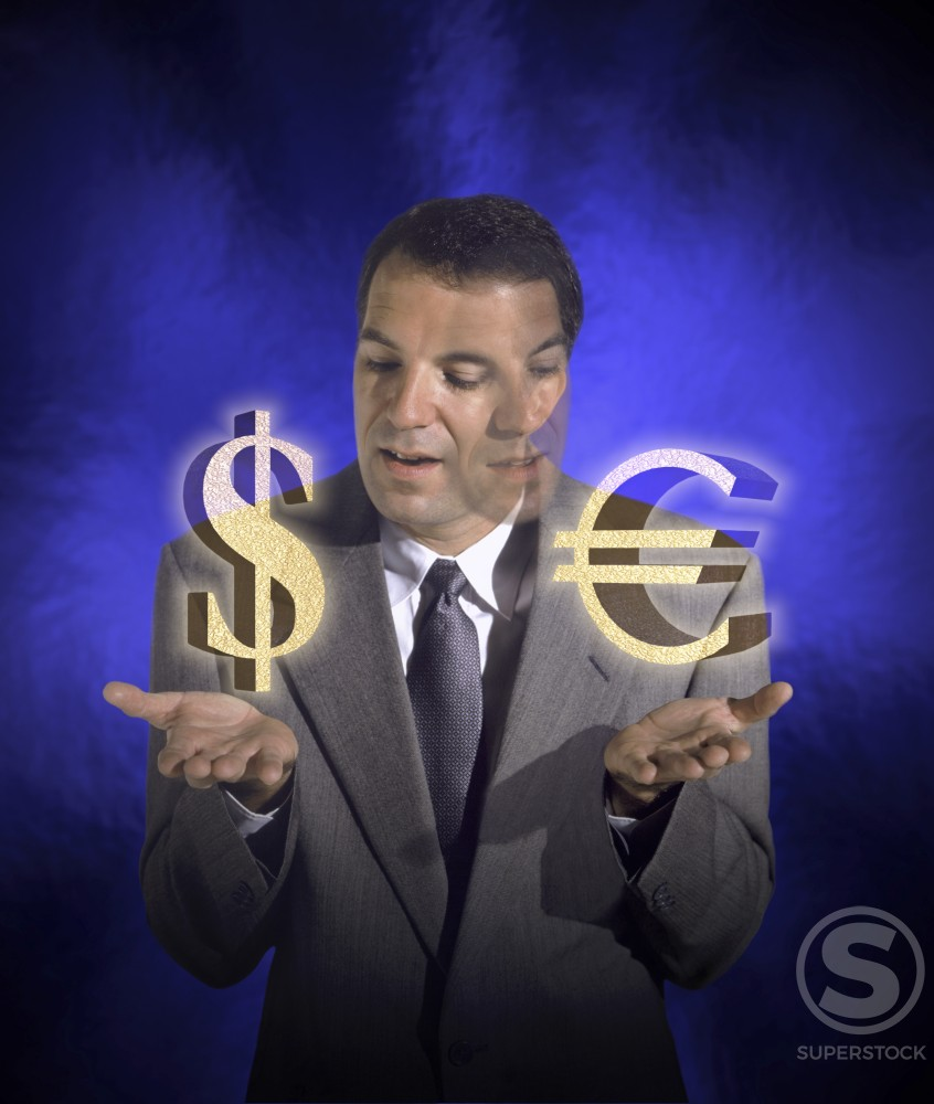 Businessman holding dollar and euro symbols : Stock Photo