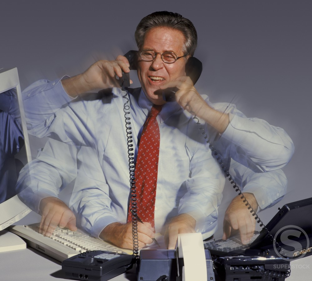 Stock Photo: 1199-118 Businessman talking on two telephone receivers